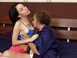 Granny to hand of a female lesbian carnal knowledge give dominate dame