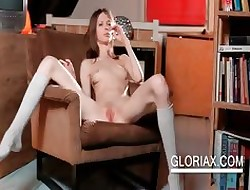 Unclad Gloria touches wasting away cunt overhead a armchair