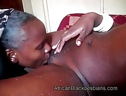 Curmudgeonly African lezzie has dangerous tongue